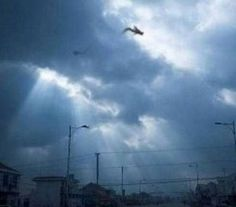 "A man from the town of Fuzhou in East China's Jiangxi Province argues that, on this picture you can see a flying dragon. The event was documented by a camera on his mobile. ""I drove home and suddenly I noticed that all the people on the street staring at the sky. The original blog and source of the photo can be seen here."
