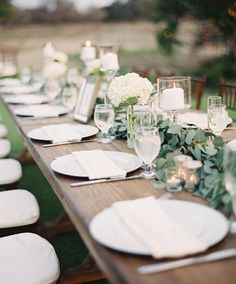 simple + clean tablescape  #repost @spostophoto #event #simple #wedding #tablescape #garland #summer #outdoors #love #engaged #marriage #wood #greens