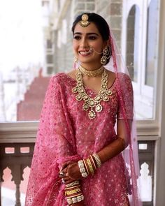 What an elegant and stunning pink lehenga paired with net choli and floral design! The stone studded neckpiece and earings are a good combination to the lehenga and an excellent match for your intimate wedding look! (C) Israni Photography #wittyvows #intimatewedding #homewedding #brideandgroom #bridalhair #bridalmakeup #bridallehenga #bridaloutfit #bridallook #pinkleheng Big Fat Indian Wedding, Indian Wedding Jewelry, Indian Bridal, Bridal Makeup Looks, Bridal Looks, Bridal Style, Intimate Wedding Ceremony, Intimate Weddings, Bridal Jewelry Sets