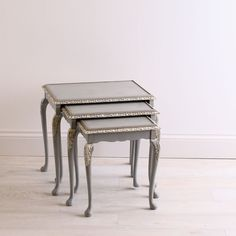 Mahogany nest of tables with unique, delicate carved cabriole legs; restored and hand painted in a bluish grey, distressed and finished off with a dark wax.
