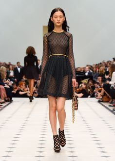 Dark forest green cotton tulle long-sleeved dress with flocked polka dots and The Belt Bag – Oblong in black leather and House check. Discover the collection at Burberry.com