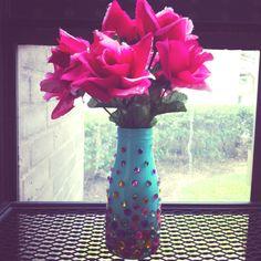 Starbucks bottle. Pretty paint. Sparkles, and flowers!