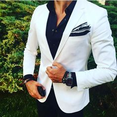 Sleek white mens jacket with navy shirt and patterned pocket square. The secret to a successful look is in the details!