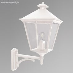 Turin Grande TG1, is a traditional 19th century outdoor wall-mounted lantern design with the lantern standing superior to its mounting bracket. It's part of the Turin family of wall, pedestal, pole and ceiling lanterns and lamp posts, ideal where a consistent design style is required across different types of fitting.