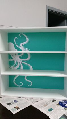 I've always wanted to do this to a shelf and now I finally have: vintage octopus in silver gilt on turquoise background