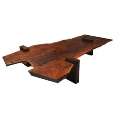 Large Scale Walnut Slab Coffee Table by Richard Patterson | From a unique collection of antique and modern coffee and cocktail tables at https://www.1stdibs.com/furniture/tables/coffee-tables-cocktail-tables/