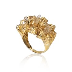 Niza Huang Chunky Cocktail Ring with Herkimer Diamonds: This stunning ring by Niza Huang invokes the intricate shapes of natural rock. It is embellished with the mystical Herkimer diamond quartz, a stone known for its clarity, for a subtle yet alluring effect.