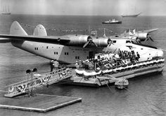 """""""Pan American's Philippine Clipper tied up an being prepped for her next flight across the Pacific. Airplane Flying, Flying Boat, Helicopter Plane, National Airlines, Float Plane, Nose Art, Air Travel, Fighter Jets, Aircraft"""