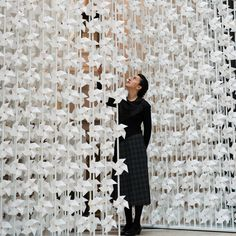 Lebanese designer Najla El Zein has installed 5000 spinning paper windmills in a doorway at the V&A museum in London.