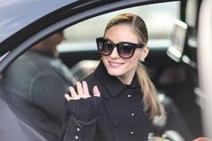 Olivia Palermo wears a black military jacket and orange pants outside the Miu Miu show during Paris Fashion Week Womenswear Fall/Winter 2017/2018 on March 7, 2017