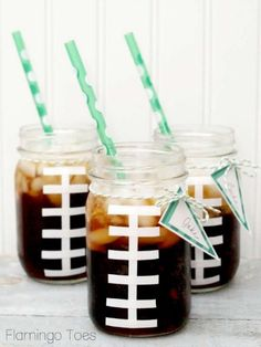 All you need is some mason jars with nothing on at least one side. I cut white electrical tape strips into half and taped them into a football stitches pattern on the side of the jar. Fill them up with root beer and you have super adorable football mason jars!  I have a printable for these Game Day flags – to prevent drink swapping or confusion. You can just write on your name and attach it to the jar with a little twine. Super easy.
