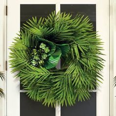 Lend a tropical touch to your door's decor with our Isle of Palms Wreath. Luscious, lifelike palm fronds and succulents craft an island-inspired greeting for guests. Suited for outdoor use but best if kept undercover, and will have a longer lifespan if kept away from the elements.8.5 thickFor indoor/outdoor use, but best if kept undercover if used outdoorsIncludes faux palm leaves and faux succulents</p.