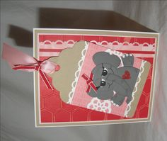 This adorable paper pieced Elephant Valentines Day card is created using Stampin' Up! stamps, cardstock, ribbon, punches, accessories, and designer series paper. The color palette is Real Red, Crumb Cake, Pretty in Pink, Basic Gray, Basic Black, and Whisper White. The inside is blank for your own personalization.  Greeting on the Inside: Blank so you can write as little or as much as you wish.  Card created using Stampin Up! products  Envelope included.  Dimensions: 4.25 x 5.5  Visit my…