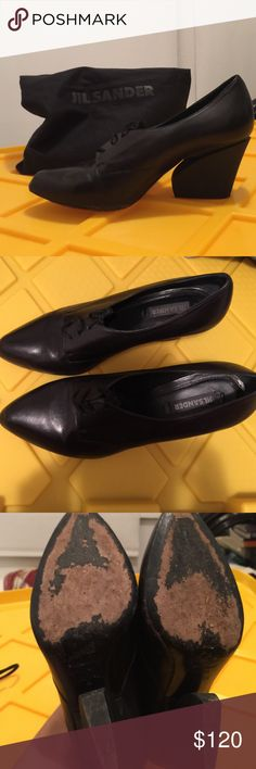 Jil Sander sculptural heels size 37.5 Sculptural Jil Sander black leather wedge-like heels with laces. Only worn a couple of times, excellent condition. Size 37.5. If your offer is high enough, I'll include the dust bag. Jil Sander Shoes Heels
