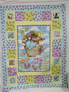 """Noah's Ark baby Quilt """"Two by Two"""" is full of lots of happy little animals in beautiful colors. This quilt is handmade pieced and quilted. The backing fabric is as adorable as the front. The center of it is a picture of Noah's Ark with all the animals aboard. The ark is surrounded by sea life and birds in a pretty blue sky. The border is made up of lots of fun animals. This is a perfect baby shower gift. Only the highest quality quilting fabrics were used in this quilt. The quilt measures…"""