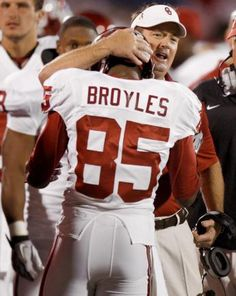 BOOMER SOONER. Bob Stoops congratulates Ryan Broyles after setting new NCAA reception record.