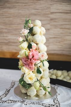 Croquembouche with scatted flowers. Astra bride - Sarah, Photo - Binh Trinh