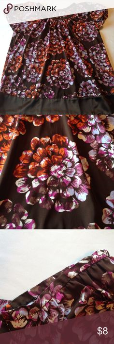 Flowy blouse GUC. Minor pilling and a few minor snags along the bottom hemline. Attempted to show in the last 2 pics. This blouse features a flowy cut, pleated neckline and a fun zipper on the back. It's a beautiful chocolate brown color with flowers in shades of purple and orange. Smoke free home. 🌺I offer a 15% discount when you bundle 2 or more listings 🌺 Daisy Fuentes Tops Blouses