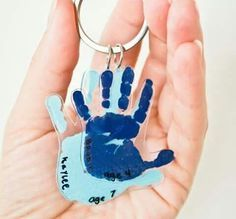 Hand on shrink wrap paper for key chains More