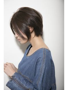 Haircut and denim dress.