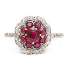 Antique Ruby Flower Ringsee larger image Flower ring of  ruby petals surrounded by diamonds. Set in platinum. French, ca. 1910 1.5 mm across