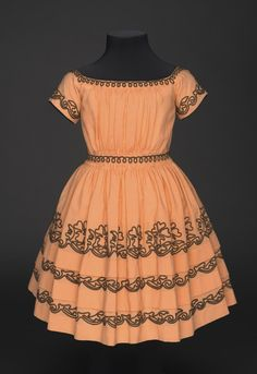 Girl's dress: wool plain weave, wool braid, silk twill ribbon. Worn by Sarah Jane Smith, born 1839 (Philadelphia Museum of Art collection)