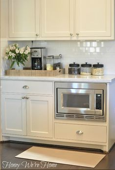 Need to see if hubby would build a cabinet similar to this for our kitchen.  It would be perfect for our kitchen!  An out of the way place for the microwave and coffee maker without cluttering up counter tops.