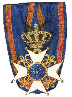 The Cross of a Knight (3rd grade) of the Order of the Netherlands Lion.  The following classes and grades exist for the Order: 1.Knight Grand Cross - Reserved for members of the Royal Family, foreign Heads of State and a select group of former prime ministers, princes and cardinals.  2.Commander - Usually conferred upon Dutch Nobel Prize winners, a few distinguished artists, writers and politicians.  3.Knight.