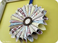 LOOOOOVE this wreath. Would be so quick and easy. Definitely making this one. Plus I have oddles of scrapbooking paper!