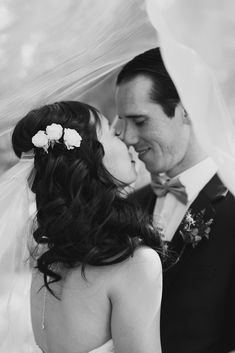 Chateau Lake Louise Wedding, bride groom portrait, mountains, romantic black and white veil photo