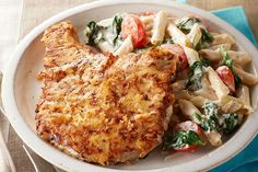 This one-skillet dish has it all: Parmesan-crusted pork chops, wilted spinach and penne pasta in a garlicky Caesar dressing.