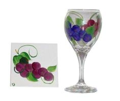 ArtisanStreet's Set of 2 Hand Painted Grape Wine Glasses & Matching Coasters. Made to Order, Signed by ArtisanStreet. $80.00. Dishwasher safe but not recommended. Individually hand painted & made to order & signed by artisan. Glasses are 7 inches tall; coasters measure 4 x 4 inches. 2 grape design wine glasses with 2 matching coasters, felted on back. Great housewarming gift, or buy for yourself. Set of 2 wine glasses and coasters with matching hand painted grape design. Coaster...