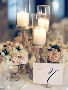 Different height candles. Multiple mini flower arrangements instead of one large. Elegant St Louis Wedding - Elizabeth Anne Designs: The Wedding Blog