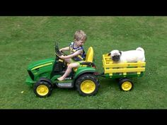 PRODUCTS USED IN THIS VIDEO: Peg Perego John Deere Ground Force Tractor with Trailer:     Cute video of a little boy who loves giving his dog a ride on his John Deere tractor .  For more