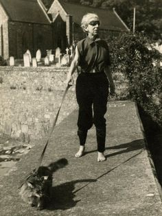 Claude Cahun walking her cat, 1949