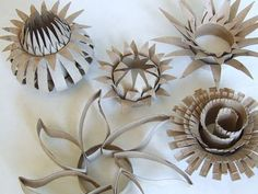 Making flowers out of toilet paper rolls