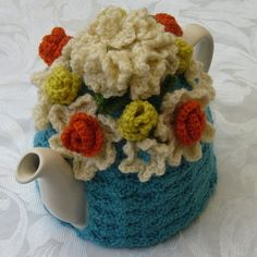 Handmade crochet tea cosy in blue