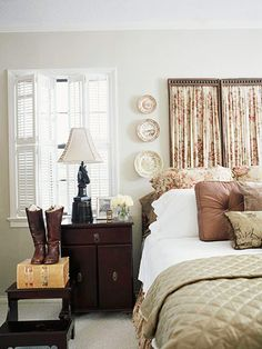 Luxury and Comfort  Floral sheets shirred on an antique screen and mounted to the wall make a blossoming headboard. Chocolate brown, warm gold, and white with touches of rose is the warm and rich color palette in this cottage bedroom.