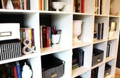 Bookshelf. White objects interspersed throughout give it continuity.