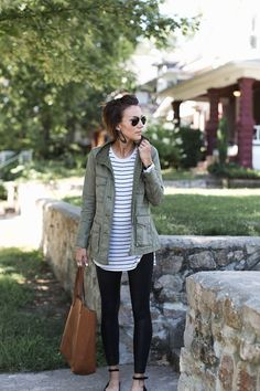 Updated flats, black leggings, the perfect striped tee, military jacket, and leather earrings. Fall outfit idea.
