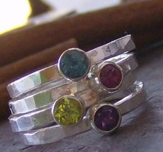Love these!  Stackable birthstone rings with names engraved on the back.