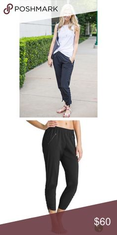 Athleta Aspire Ankle Pant in Black Size 2 The Featherweight Stretch™ pant that goes from studio to street thanks to a sporty chic tapered leg that scrunches up for more breathing room. INSPIRED FOR: studio workouts, studio To Fro, lifestyle To Fro. Elastic waist cinches in a perfect fit without any drawstring.  4 Pockets: 2 front angled zip pockets create a slimming effect, 2 rear welt pockets for stashing on the go Ruching in all the right places for a just-right fit Athleta Pants Track…