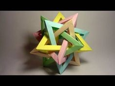 A tetrahedra composed of five intersecting pyramidal shapes. Each module has 5cm x 15cm. You'll need 6 modules for each tetrahedron (total of 5 x 6 = 30 modules).