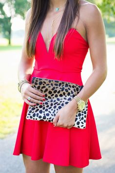 Women's fashion | Sleeveless red dress and leopard print clutch