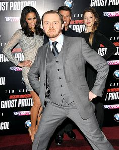 Simon Pegg Photo bombing Tom Cruise and 2 others at the premiere of Mission Impossible Ghost Protocol. Celebrity Photobombs - Us Weekly
