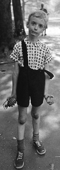 Folks just get on your damn nerves ... CHild with a Toy Hand Grenade in Central Park, NY, DIane Arbus, 1962