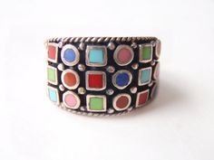 Fabulous mod 1960s mid century multi color enamel and sterling silver wide band ring. Modernist oxes and squares and a landscape of bold colors are the focus of this ring. Further enhances with oxidization which makes the colors pop.  CONDITION: Excellent vintage without damage or repairs. All enamel in tact.  SIZE: Sized for a ladies 8 1/2 to 9 and can be sized up or down.  More from Deco Daze Antiques:  ► For more ANTIQUARIAN BOOKS https://www.etsy.com/ca/shop&#x2F...