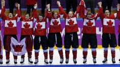 Members of Team Canada celebrate during the medal ceremony after the women's ice hockey tornament at the 2014 Winter Olympics, Friday, Feb. 21, 2014, in Sochi, Russia.