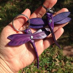 Cool little dragonfly key ring made from vegetable tanned leather with tooled details. Fun to play with and hold. Vegetable tanned leather ages beautifully and gets better with use! Available in Brown or Natural and now in PURPLE! Dragonfly body is 3.5 long, total length with ring is 4.5 3.5 wingspan. Also, this Dragonfly comes in a NECKLACE version! http://www.etsy.com/listing/494118489/dragonfly-leather-necklace-tooled