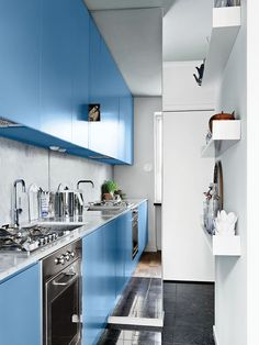 Marble countertops and backsplash with powder blue painted Ikea cabinets.